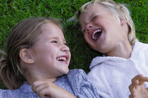 Pair of children laughing